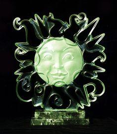 "Sunshine. sand carved pearlised on 3/4"" plate glass"