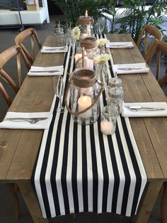Rustic table with black and white stripe table runner