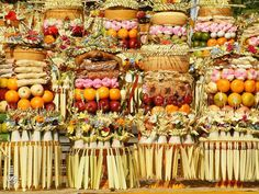"""Whenever there is a Hindu ceremony the Balinese Hindu's always offers """"gebogan banten"""" as a gratitude to God, the creator of the universe and to the ancestors. """"Gebogan"""" or also called """"Pajegan"""" is a beautiful offerings arrangement of fruits, cakes, snacks, sometimes grilled chicken and colourful flowers which creatively decorated with young coconut leaves and topped with canang sari by Balinese Hindu's in Bali. Puri Lumbung!! Bali Escape - July 2019 check out www.amorescapes.com"""