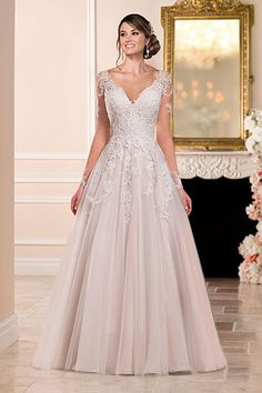 Wedding gown by Stella York.Check out more gorgeous dresses in our Stella York gown gallery ►