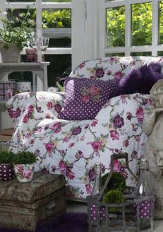 Comfy chair...I would surround it with bookcases and add a small table with a lamp for reading and holding my cup of tea. :)