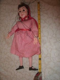 Little Red Riding Hood marionette from Hazelle's in Kansas City.  I think this might be around ten Hazelle's Reds I have now.  Purchased September 16, 2015 online auction for $14.99 + $5.99 s&h.  Every time I have guessed that I have a duplicate costume, I learned that it was a different material.  So I am not even going to guess on this one and see what it looks like when she gets here.