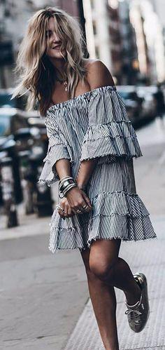 boho girl wearing stripped dress