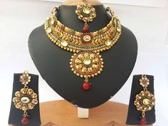Gold plated clear and Ruby,Emerald stones Indian Polki Jewellery set-03PLKM05  http://www.craftandjewel.com/servlet/the-1831/Gold-plated-clear-and/Detail