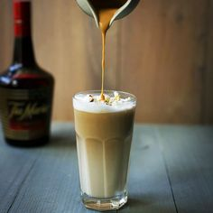 A funny coffee recipe with a twist. Coffee with whipped milk, Dulce de leche caramel, Tia Maria and a handful of popcorn.