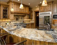 A Rustic Kitchen Made All The More So By The Rough Edged Granite Counter  Top.