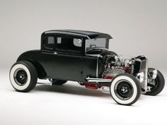 1930 Ford Model A Coupe...we will have a older model vehicle and take hot dates out in them! ;)