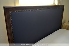 DIY wood framed upholstered headboard - navy blue vinyl with stained frame via Addicted 2 Decorating