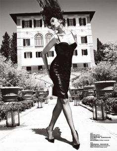Fabulous corset and leather skirt with hair in the air.