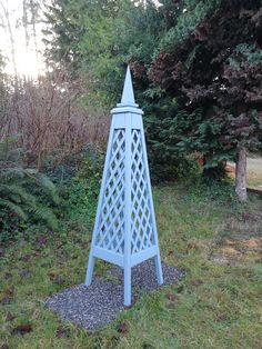 Diamond Trellis cedar obelisk with Spire finial finished with Jamestown Blue Solid Stain. Custom and stock obelisks available, contact us with your ideas or questions.