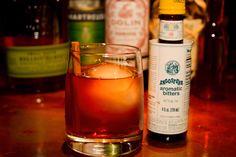 The Kessel Run  1 oz. Bulliet Rye  1 oz. Dolin Sweet Vermouth  1 oz. Plantation 5 yr. Rum  1/2 oz. Green Chartreuse  (1 dash cinnamon tincture)  3 dashes Angostura Bitters  Cinnamon Stick  Ice Chunk