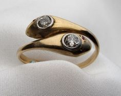 Victorian Diamond Snake Ring  Circa 1890. This elegant yellow gold ring represents two snakes coiled around each other, a Victorian symbol of eternal love. A diamond winks from each snake's head. - See more at: http://isadoras.com/victorian-diamond-snake-ring.html#sthash.gXTHGpQx.dpuf
