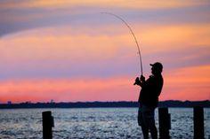 Destin fishing with the sun setting