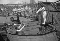 A couple swimming in their 'Sportpool' erected on an Oxford Street roof, London, 1937