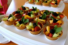 Healthy Birthday Treats!  My daughter's school does not allow cupcakes or cakes, so this was the perfect individual treat! Mini waffle bowls and cut up fruit - cheap and cheerful.   Do not put any juice from the fruit in the waffle bowls and don't put it in too early, otherwise the waffle bowls will get soggy!