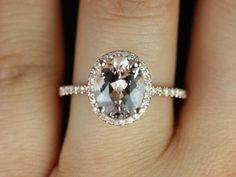 Federella Original Size 14kt Rose Gold Thin Oval Morganite Halo Engagement Ring (Other metals and stone options available). $1,000.00, via Etsy.
