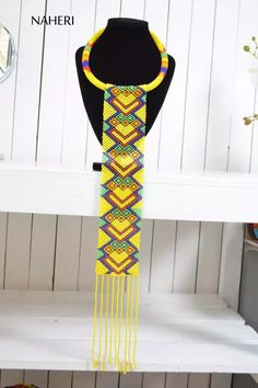 African beaded tribal long necklace zulu maasai jewelry Elegant and superbly crafted. * color - multicolored, main color yellow * neck width - 18 * length of hanging part - 17 Thank you for passing by :) Rope Jewelry, Pendant Jewelry, Jewelery, Crochet Necklace, Beaded Necklace, Necklaces, African Style, African Fashion, Yellow Necklace