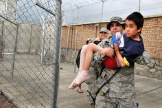U.S. Air Force Staff Sgt. Billy Atherton carries an Afghan child to a field hospital at Bagram Airfield, Afghanistan, May 5, 2011