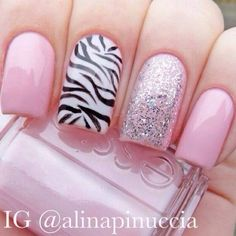 "Pink with Zebra accent nail art:  She used @Essie Martin Martin - ""muchi muchi"" and ""marshmallow"", kiko - no. 271 and a black striper"