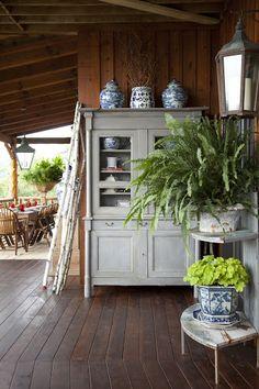 Big fern on the porch in a galvanized bucket...