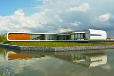 Waterstudio.NL unveils daylit waterfront family home in The Netherlands