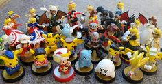 Custom amiibo collection by Peachy Customs.  Super sonic, pikachu, charizard, pokemon, game of thrones, military, catbug, lord of the rings, fallout, voltron, tales of symphonia, king kong, naruto, and supernatural are all represented!  Can you spot them all?