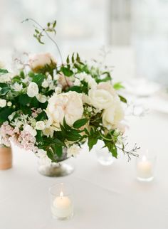 Spring inspired centerpiece. Photography : Caroline Yoon Fine Art Photography Read More on SMP: http://www.stylemepretty.com/new-york-weddings/new-york-city/2016/08/19/minimal-and-modern-nyc-wedding/