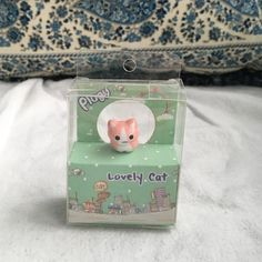 Pink cat dust plug Pink plastic cat dust plug for phones, never used, box never opened Accessories Phone Cases