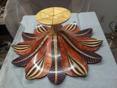 Segmented Flower Bowl - Woods used are purpleheart, yellowheart and birdseye maple. The birdseye maple was dyed. By artist BenHedNed