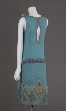 Wedding dress, 1927. Silk crepe, glass beads, metallic thread embroidery. Maker unknown. Gift of Robert C. Woolard. 1991.408a Sponsored by Laura Barnett Sawchyn