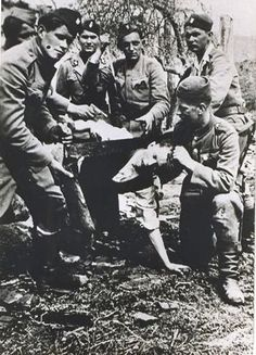 Jasenovac prisoner being held with pistol, saw and knife.