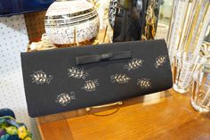 Vintage purse decorated with hand-drawn leaf designs.