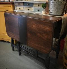 Absolutely adorable and super versatile antique gate leg drop leaf table! The top was restored with General Finishes Java Gel Stain and Satin High Performance Top Coat. The grain sack stripes and legs are painted with Chalk Paint® in Graphite, which is sealed with Dark Chalk Paint® Wax!