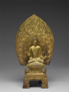 Gilt Bronze Shakyamuni Buddha and Stand - Northern Wei dynasty (477 A.D.)  Height: 40.3 cm
