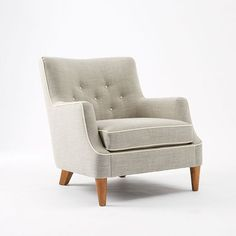 This 'Livingston' chair is a pricy option for your guest room, but isn't the shape and finish fun?  It looks cozy, too, and comes in quite a few colors.