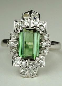Green Tourmaline Art Deco Diamond Ring,1920s. Platinum, 14kt White Gold, Diamonds, Tourmaline. A New Style of Jewelry started to emerge in the 1920's. A strong desire to eliminate the boring 'Flowing Lines' of Art Nouveau and incorpor...