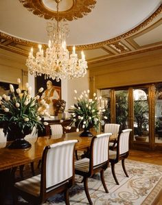 Luxurious Opulence Is Reflected In This Dining Room With Its Gold Leaf Custom Moldings The Crystal Chandelier Guides You Into While Plush