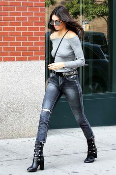 Oh, those boots! On Jenner: Boohoo Simone Off the Shoulder Bodysuit ($20); AMO Babe Jeans ($260); Isabel Marant Arnie Boots ($1335); Linda Farrow sunglasses; Saint Laurent bag.