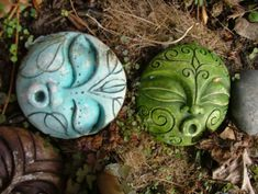 Cool clay faces. Maybe make some for the 5 senses garden or for each of the 5 elements of nature.