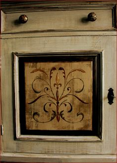 Painted buffet door detail with scrollwork. i love this!