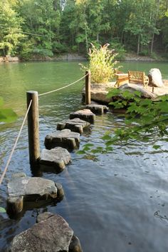 love the stepping stones out to the big rock island!  Look at the details...each rock has wooden piers notched for fit and support. by cassi...