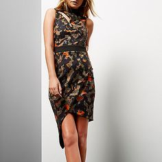 Jersey ponte fabric Camouflage print and sequin detail Slit across neckline High neck Black fitted waistband Asymmetric wrap skirt  Camo classy.