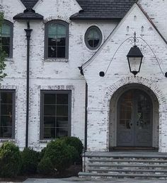 It's the only paint that will give you a beautiful and natural flat, chalky, or antique limewash finish without sacrificing the durability, longevity Exterior House Colors, Exterior Paint, Exterior Design, White Wash Brick Exterior, Painted Brick Exteriors, Painted Brick Houses, White Brick Houses, Grey Houses, Pintura Exterior
