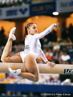 Female Gymnastics in white one piece outfit Gymnastics Images, Gymnastics Poses, Gymnastics Photography, Sport Gymnastics, Artistic Gymnastics, Olympic Gymnastics, Sporty Girls, Gym Girls, Gymnastics Flexibility