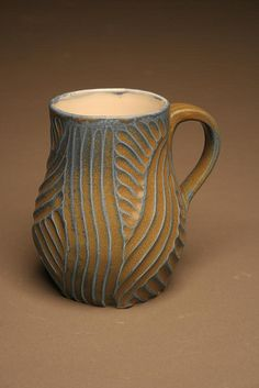blue and tan mug from Twisted Terra,White stoneware, thrown and carved. Reduction fired.