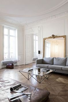 A chic Parisian apartment with a mix of glamorous traditional and minimalist modern furnishings.