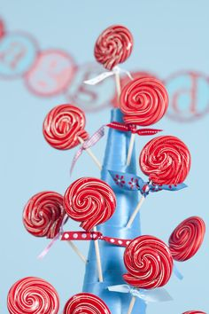 Kids table....styrofoam tree lollipop stand...excellent idea...maybe even for cake pops