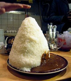 Man Challenges Japan's Largest Mountain of Curry and Rice, Lives to Tell the Tale