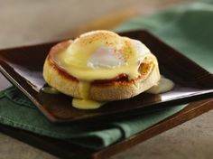 Classic Eggs Benedict  Hollandaise Sauce 3 egg yolks 1 tablespoon lemon juice 1/2 cup firm butter  Eggs Benedict 3 English muffins 3 tablespoons butter, softened 1 teaspoon butter 6 thin slices Canadian-style bacon or fully cooked ham 6 eggs 4 teaspoons distilled white vinegar Paprika, if desired