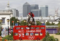 McLain Ward rides Antare, Team USA, during the equestrian individual jumping second qualifier in Greenwich Park